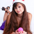 Attractive young girl with christmas presents wondering — Stock Photo #6963524