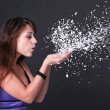 Portrait of funny lovely teenage girl inflating snowflakes, stud — Stock Photo