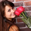 Romantic portrait of a pretty teenage girl with a gorgeous bouquet of red r — Stock Photo