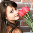 Romantic portrait of a pretty teenage girl with a gorgeous bouqu - Stock Photo