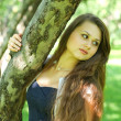 Foto Stock: Abstract portrait of beautiful young womrelaxing in summer park