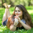 Dreaming beautiful young woman relaxing in summer park — Stock Photo #6963597