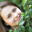 Portrait of beautiful young woman relaxing in summer park - Stockfoto