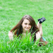 Portrait of cute young girl relaxing on the lawn — Stock fotografie