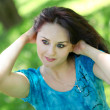 图库照片: Abstract portrait of beautiful young womrelaxing in summer park