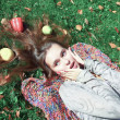 Stock Photo: Strange girl lying with vegetables in amazement