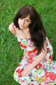 Portrait of tired young girl relaxing in spring park — Stock Photo