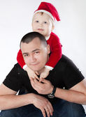 Father with his little son sitting pick-a-back in festive unifor — Stock Photo