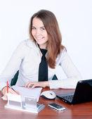 Beautiful attentive businesswoman signing document — Stock Photo