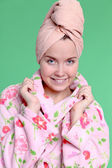 Portrait of beautiful woman in terry dressing gown — Stock Photo