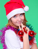 Cute young girl with christmas balls — Stock Photo