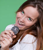 Portrait of gorgeous singer girl with beautiful green eyes — Stock Photo