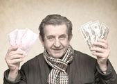 Elderly happy man with pack of money — Stock Photo