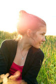 Profile of beautiful young girl with summer sunshine in the evening — Stock Photo