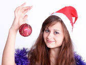 Attractive young girl with christmas presents wondering — Stockfoto