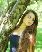 Abstract portrait of beautiful young woman relaxing in summer park — Stock Photo