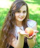Gorgeous young girl with sappy apple — Stock Photo