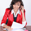 Stock Photo: Attractive businesswoman talking by phone
