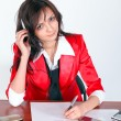 Stock Photo: Attentive businesswoman signing document