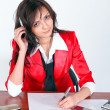 Attentive businesswoman signing document — Stock Photo