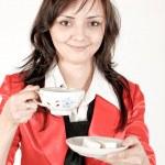 Beautiful brunette lady drinking bracing coffee — Stock Photo