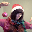 Beautiful brunette woman with christmas ball — Stok fotoğraf
