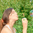 Attractive girl blowing soap bubbles — Stock Photo #6970398