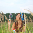 Attractive young girl with soap-bubbles — Stock Photo