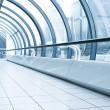 Stock Photo: Vanishing corridor in contemporary airport walkway