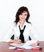 Beautiful business lady signing document — Stock Photo