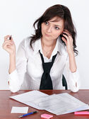 Beautiful brunette lady dreaming at work — Stock Photo