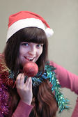 Beautiful brunette woman with christmas ball — Stock Photo