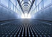 Symmetric escalator inside contemporary airport — Stock Photo