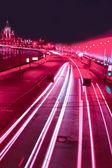 Movimiento de rojo la noche en las calles urbanas — Foto de Stock