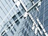Dark transparent glass wall of office building at night — Stock Photo