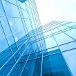 Turquoise glass high-rise corporate building — Stock Photo