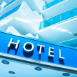 Hotel sign over light blue modern facade — Stock Photo