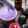 Herbal salt lavender and spa stones — Stock Photo
