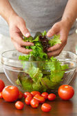 Man preparing salad — Stock Photo