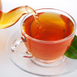 Tea pouring into cup — Stock Photo