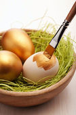 Painting easter eggs — Stock Photo