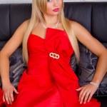 Beautiful female in red dress — Stock Photo