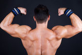 Muscular man posing with back — Stock Photo