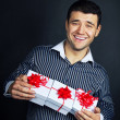Portrait of male with present box - Stock Photo