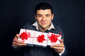 Portrait of male with present gift — Stock Photo