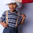 A little boy with a santa hat — Stock Photo #7728301
