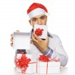 Young man with christmas gifts — Stock Photo #7935871