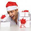 Young man with christmas gifts — Stock Photo