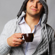 Handsome man with cup of coffee - Stockfoto