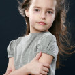 Portrait of a happy young girl in studio — Stock Photo